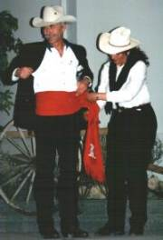 Hugh being fitted with the Red Sash Award